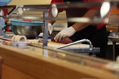 sushi chef slicing fresh tuna